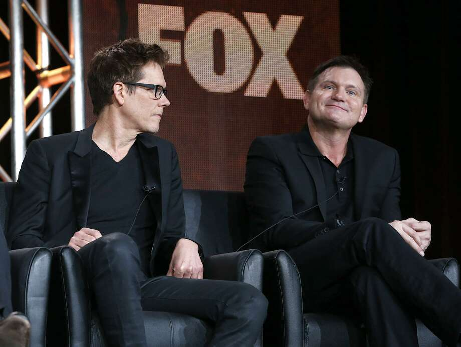"""Kevin Bacon and Executive Producer/Creator Kevin Williamson from """"The Following"""" attend the Fox Winter TCA Tour at the Langham Huntington Hotel on Monday, Jan. 7, 2013, in Pasadena, Calif. (Photo by Todd Williamson/Invision/AP) Photo: Todd Williamson/Invision/AP / Invision2013"""