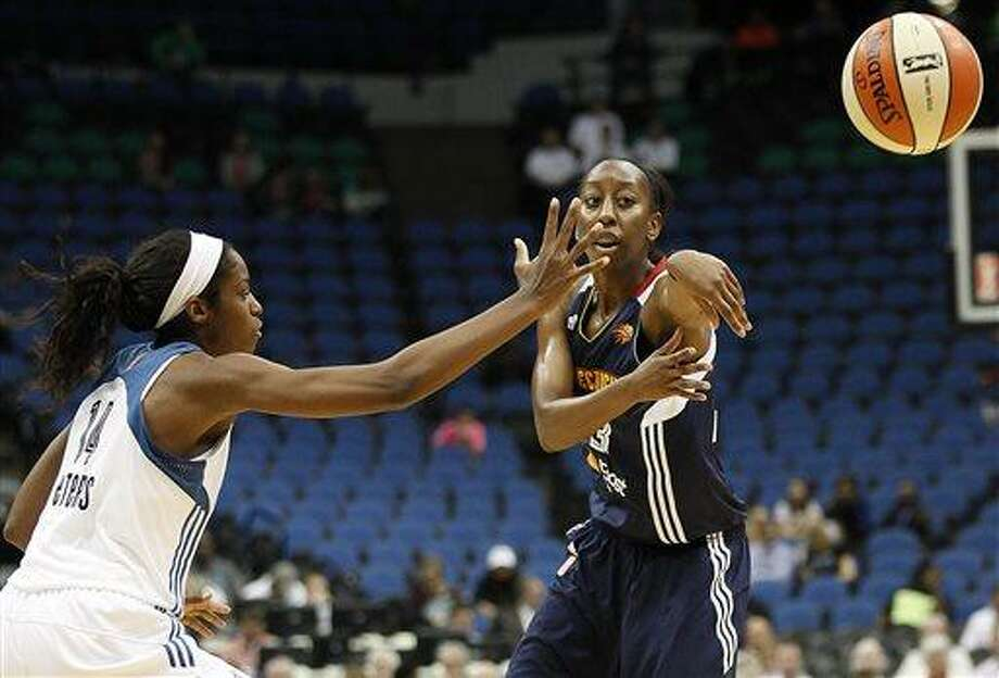 Connecticut Sun guard Allison Hightower (23) passes the ball away from Minnesota Lynx forward Devereaux Peters (14) in the second half of a WNBA preseason women's basketball game, Tuesday, May 21, 2013, in Minneapolis. The Sun won 80-88. (AP Photo/Stacy Bengs) Photo: AP / FR170489 AP