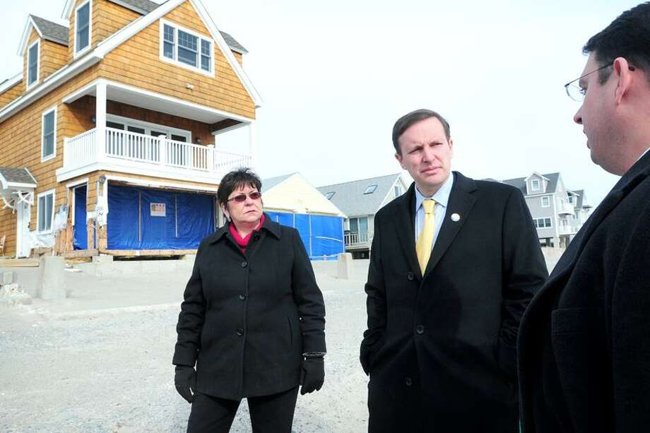 State Rep. Kim Rose (left) and U.S. Senator Chris Murphy (center) listen to Milford Mayor Ben Blake (right) talk about the issues homeowners face along the shoreline in Milford during a walk at Bayview Beach in Milford on 1/25/2013.Photo by Arnold Gold/New Haven Register    AG0481F