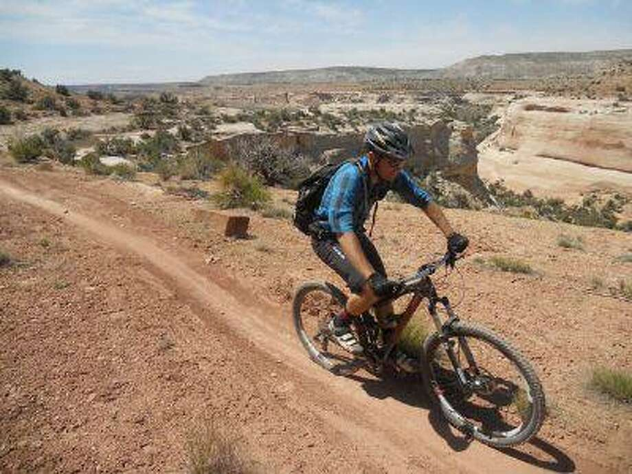 Josh Coffin, a guide for Western Spirit Cycling Adventures, travels along the Western Rim trail in Utah. Photo: POST_UPLOAD / The Denver Post