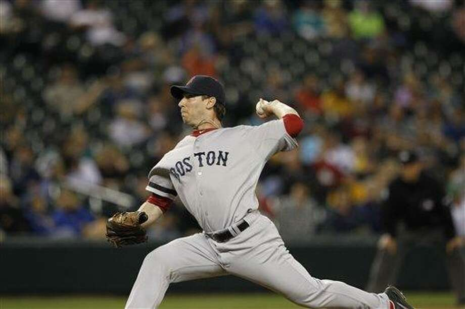 Boston Red Sox Craig Breslow in action against the Seattle Mariners in a baseball game Tuesday, Sept. 4, 2012, in Seattle. (AP Photo/Elaine Thompson) Photo: ASSOCIATED PRESS / AP2012