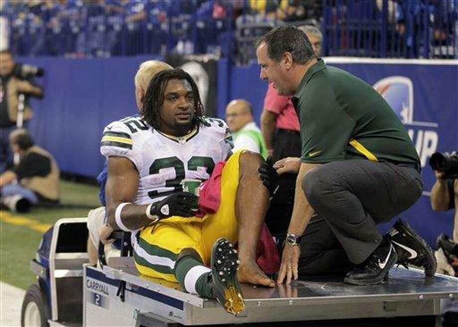 Green Bay Packers running back Cedric Benson (32) is carted off the filed during the first half of an NFL football game against the Indianapolis Colts in Indianapolis, Sunday, Oct. 7, 2012. (AP Photo/Michael Conroy) Photo: ASSOCIATED PRESS / AP2012