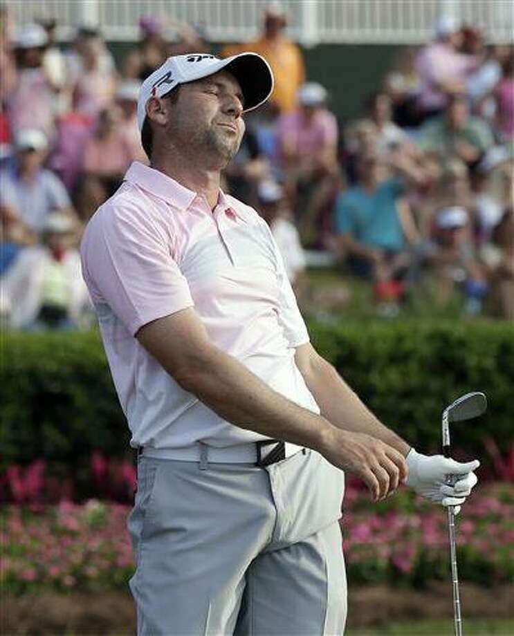 Sergio Garcia, of Spain, reacts after hitting his second tee shot into the water on the 17th hole during the final round of The Players Championship golf tournament at Sawgrass, May 12, 2013, in Ponte Vedra Beach, Fla. Photo: AP / AP
