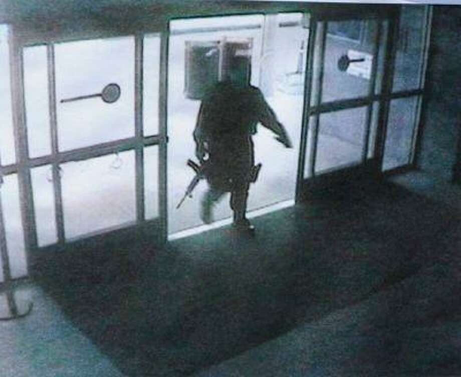 Surveillance photo of the the suspect in the Santa Monica shooting, who is believed to be John Zawahri (Santa Monica Police Department) / LANG/ DFM