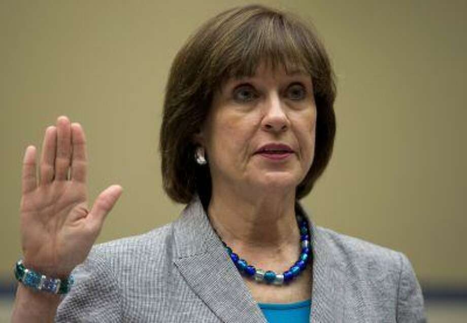 IRS official Lois Lerner is sworn in on Capitol Hill in Washington, Wednesday, May 22, 2013, before the House Oversight Committee hearing to investigate the extra scrutiny IRS gave to Tea Party and other conservative groups that applied for tax-exempt status. Photo: AP / AP