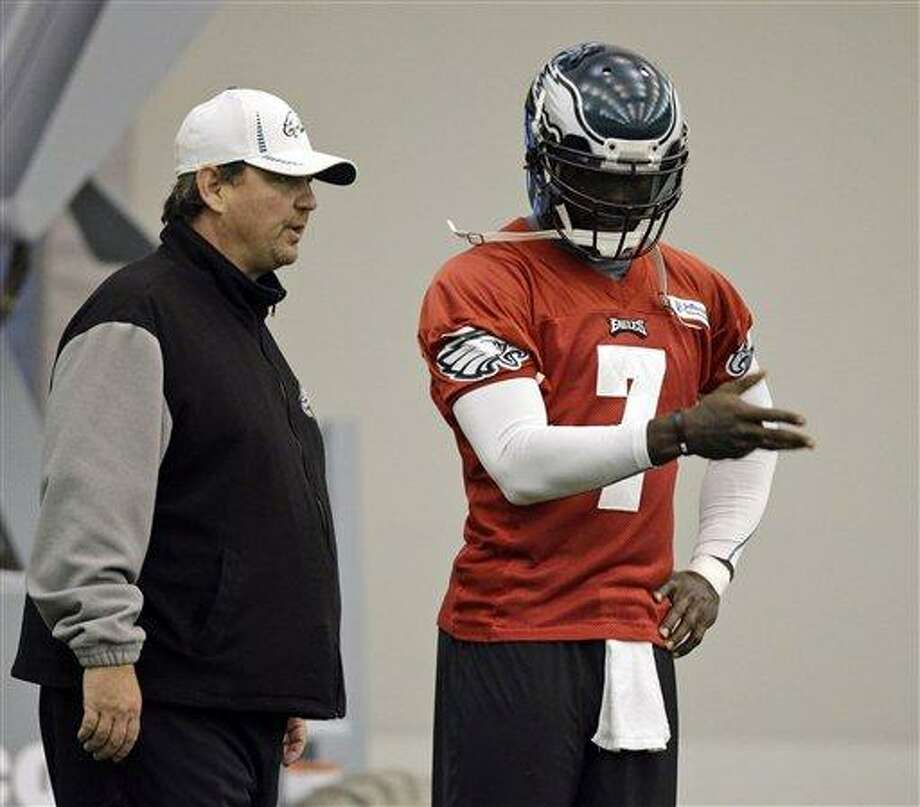 Philadelphia Eagles quarterback Michael Vick, right, and offensive coordinator Marty Mornhinweg talk on the sidelines during NFL football practice at the team's indoor practice complex, Wednesday, Nov. 7, 2012, in Philadelphia. (AP Photo/Matt Slocum) Photo: ASSOCIATED PRESS / A2012