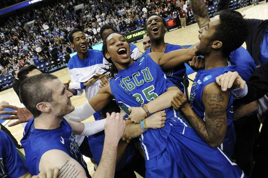 Florida Gulf Coast's Sherwood Brown, center, celebrates with teammates after their 81-71 win over San Diego State in a third-round game in the NCAA college basketball tournament, Sunday, March 24, 2013, in Philadelphia. (AP Photo/Michael Perez) Photo: AP / AP2013