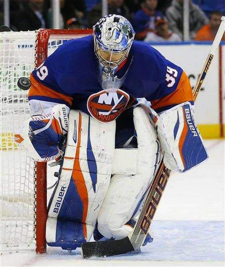 New York Islanders goalie Rick DiPietro makes a save during a recent game. The Islanders placed DiPietro on waivers Friday. (AP Photo/Paul J. Bereswill) Photo: AP / FR168017 AP