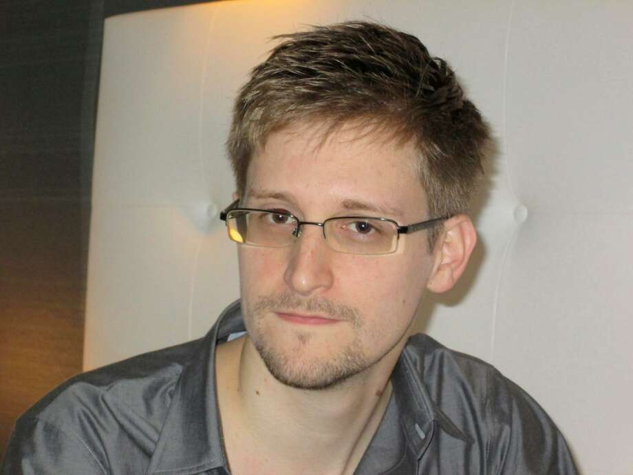 U.S. National Security Agency whistleblower Edward Snowden, an analyst with a U.S. defence contractor, is pictured during an interview with the Guardian in his hotel room in Hong Kong June 9, 2013. The 29-year-old contractor at the NSA revealed top secret U.S. surveillance programmes to alert the public of what is being done in their name, the Guardian newspaper reported on Sunday. Snowden, a former CIA technical assistant who was working at the super-secret NSA as an employee of defence contractor Booz Allen Hamilton, is ensconced in a hotel in Hong Kong after leaving the United States with secret documents. REUTERS/Ewen MacAskill/The Guardian/Handout  (CHINA - Tags: POLITICS MEDIA)  ATTENTION EDITORS - THIS IMAGE WAS PROVIDED BY A THIRD PARTY. FOR EDITORIAL USE ONLY. NOT FOR SALE FOR MARKETING OR ADVERTISING CAMPAIGNS. THIS PICTURE IS DISTRIBUTED EXACTLY AS RECEIVED BY REUTERS, AS A SERVICE TO CLIENTS. NO SALES. NO ARCHIVES. THIS PICTURE IS DISTRIBUTED EXACTLY AS RECEIVED BY REUTERS, AS A SERVICE TO CLIENTS. MANDATORY CREDIT Photo: REUTERS / X80001