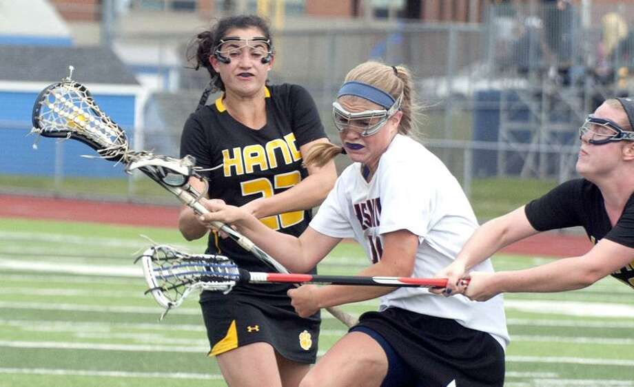 Cheshire's Alison Hoynes, middle, works her way past Hand's Brooke Barry, left, during Cheshire's 17-14 win over Hand for the SCC championship Thursday. vmWilliams/Register