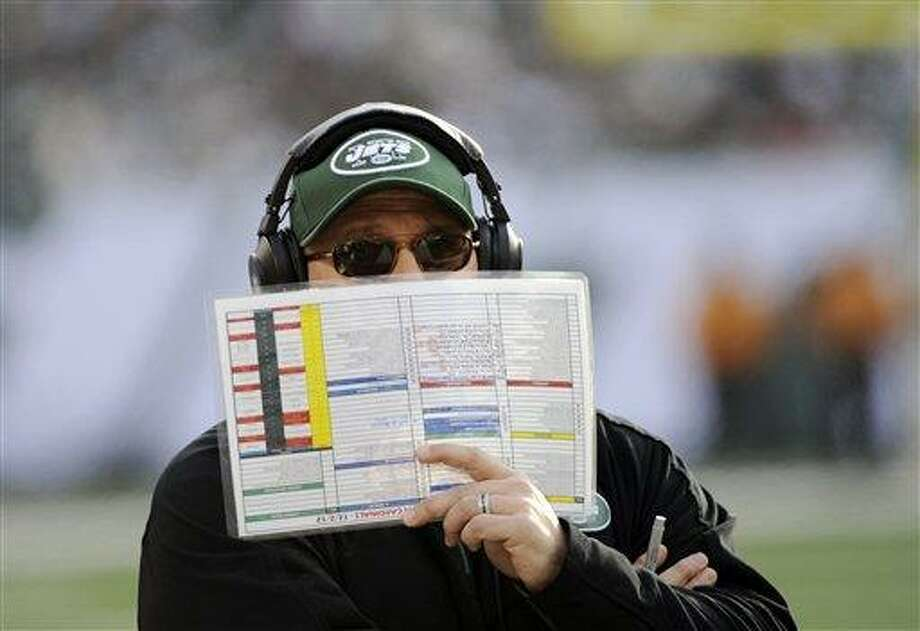 This Dec. 2, 2012 file photo shows New York Jets offensive coordinator Tony Sparano holding a play list during the first half of an NFL football game against the Arizona Cardinals in East Rutherford, N.J. (AP Photo/Bill Kostroun, File) Photo: AP / FR51951 AP