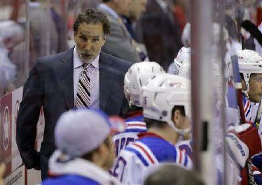New York Rangers head coach John Tortorella talks with his team in the second period of a playoff game against the Washington Capitals, May 10, 2013 in Washington. Photo: AP / AP