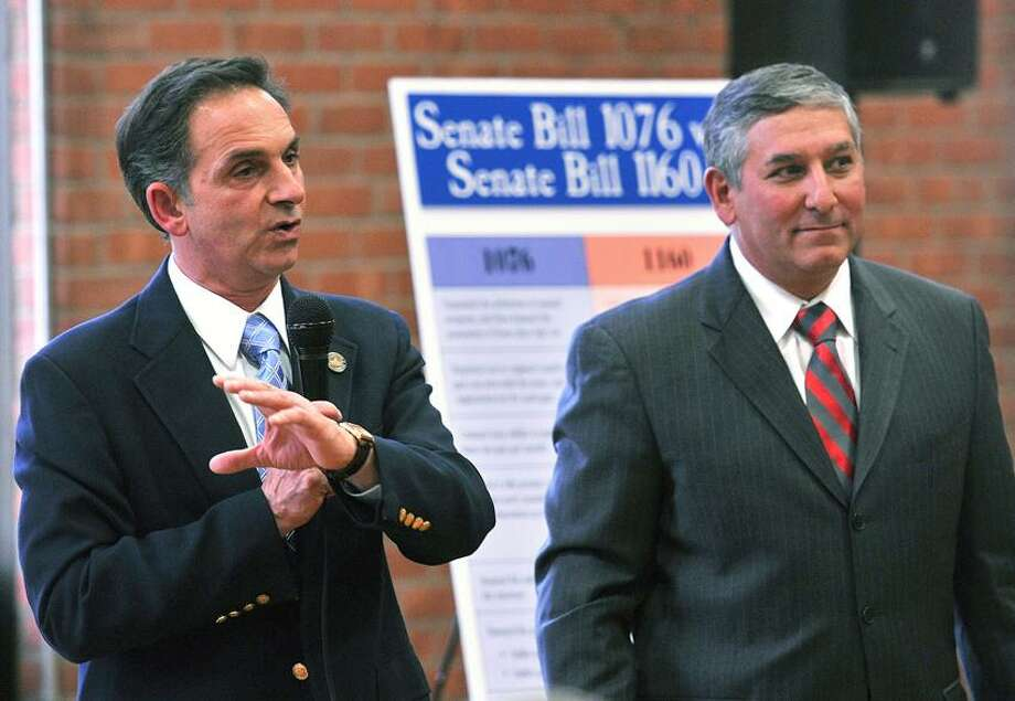 """North Haven-- State Rep David Yaccarino, R-North Haven, left, and  State Sen Leonard Fasano, R-North Haven, answer questions about the state's new gun laws during an informational meeting at the North Haven Recreation Center.  Photo-Peter Casolino/Register <a href=""""mailto:pcasolino@newhavenregister.com"""">pcasolino@newhavenregister.com</a>"""