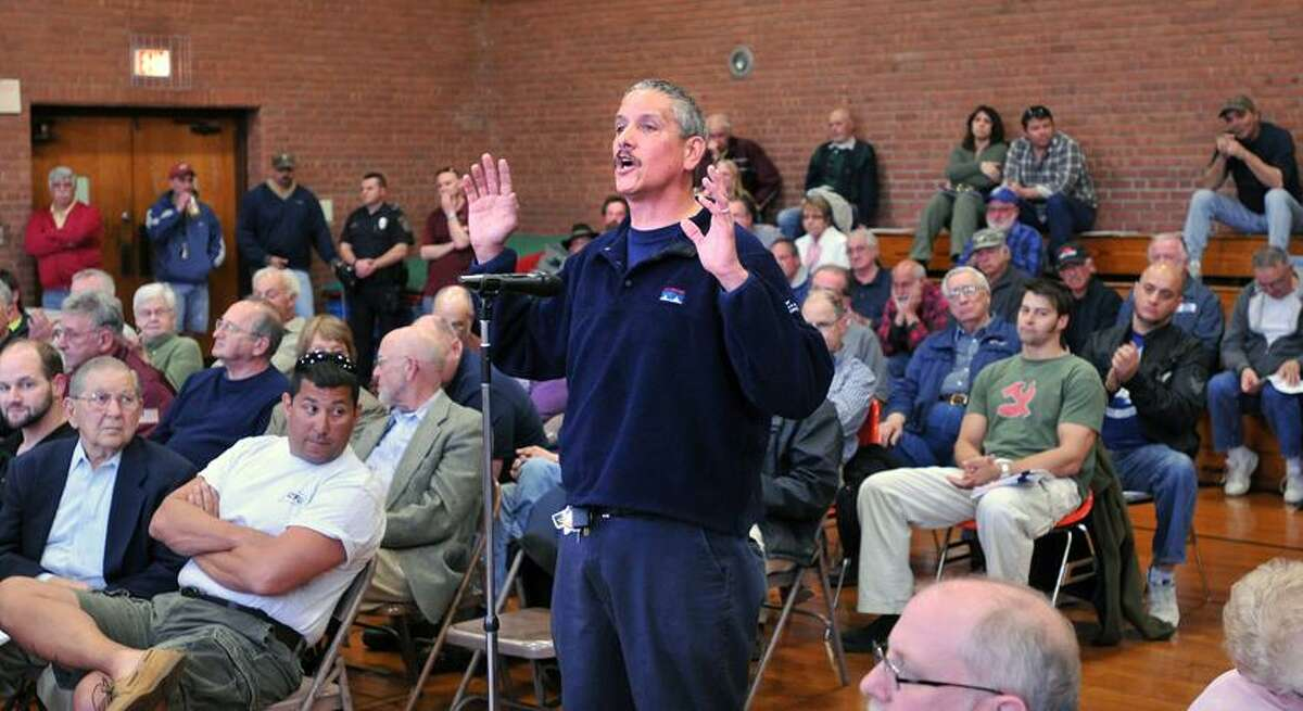 North Haven-- John Cinque of Branford had several questions for lawmakers during an informational meeting on the new gun laws at the North Haven Recreation Center. Cinque asked;