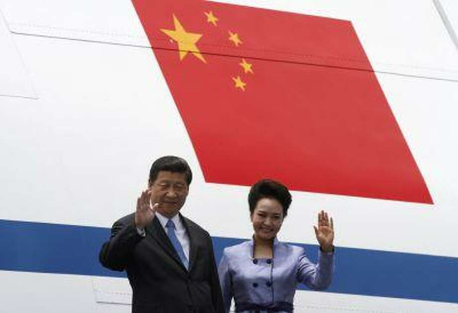 China's President Xi Jinping and his wife Peng Liyuan wave upon their arrival to the Benito Juarez International Airport in Mexico City June 4. Photo: ASSOCIATED PRESS / AP2013
