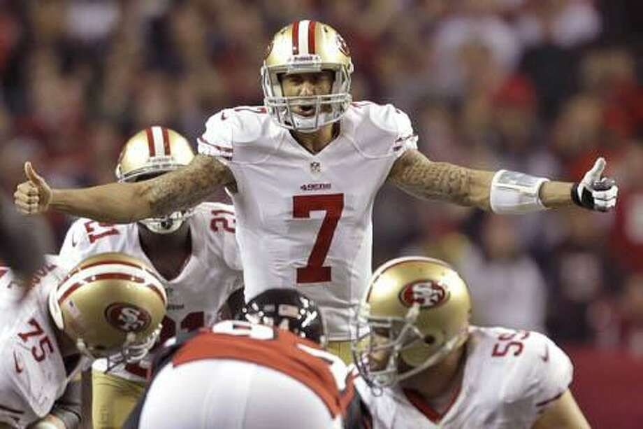 San Francisco 49ers quarterback Colin Kaepernick signals to the line during the second half of the NFL football NFC Championship game Sunday, Jan. 20, 2013, in Atlanta. (AP Photo/David Goldman) Photo: AP / AP2013