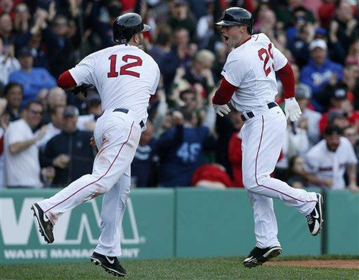Boston Red Sox's Daniel Nava (29) celebrates his three-run home run with teammate Mike Napoli (12) in the eighth inning of a baseball game against the Kansas City Royals in Boston, Saturday, April 20, 2013. The Red Sox won 4-3. (AP Photo/Michael Dwyer)
