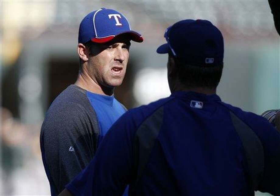Texas Rangers' Mike Olt talks to hitting coach Scott Coolbaugh, right, during batting practice before a baseball game against the Oakland Athletics Tuesday, Sept. 25, 2012, in Arlington, Texas. (AP Photo/Tony Gutierrez) Photo: ASSOCIATED PRESS / AP2012