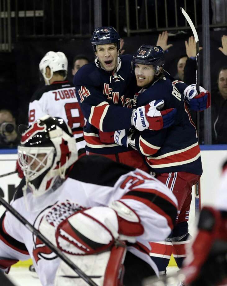 New York Rangers' Taylor Pyatt (14), top center, celebrates his goal with teammate Brad Richards during the second period of an NHL hockey game against the New Jersey Devils, Sunday, April 21, 2013, in New York. (AP Photo/Seth Wenig) Photo: ASSOCIATED PRESS / AP2013