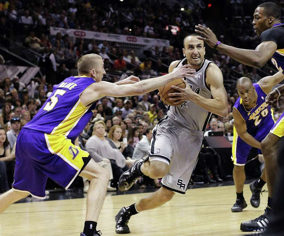 San Antonio Spurs' Manu Ginobili, center, of Argentina, drives between Los Angeles Lakers' Steve Blake, left, and Dwight Howard during the second half of Game 1 of their first-round NBA basketball playoff series, Sunday, April 21, 2013, in San Antonio. San Antonio won 91-79. (AP Photo/Eric Gay) Photo: AP / AP