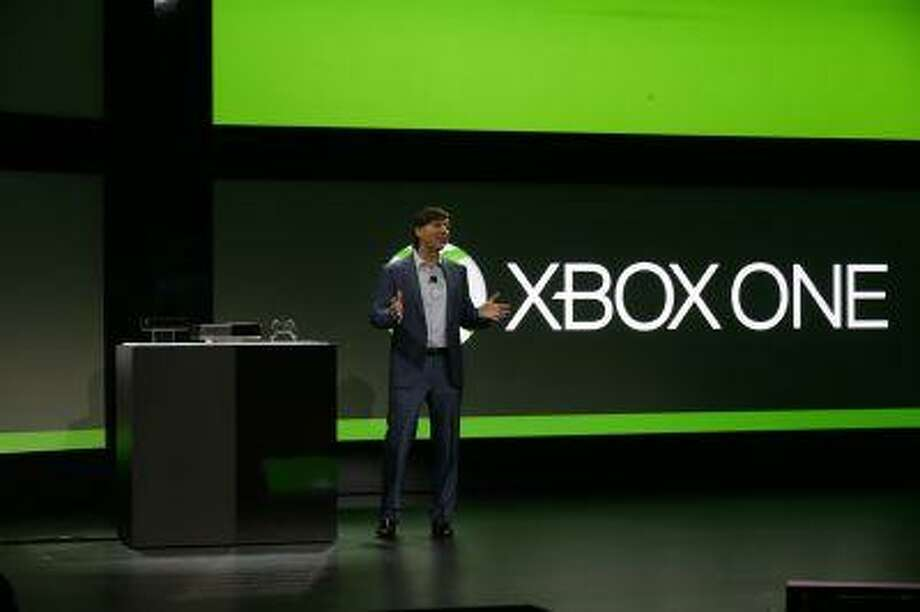 Microsoft Corp.'s Don Mattrick unveils the next-generation Xbox entertainment and gaming console system, Tuesday, May 21, 2013, at an event in Redmond, Wash. Photo: ASSOCIATED PRESS / AP2013