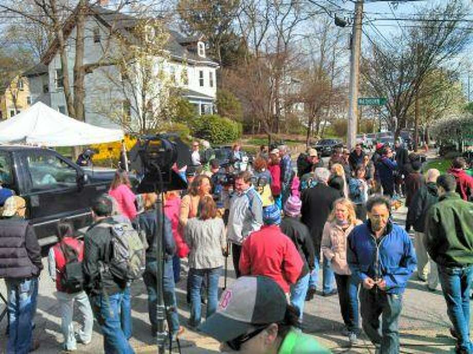 Media and onlookers gather Saturday near 67 Franklin Street, the property where the second Boston Marathon bombing suspect was captured Friday night.
