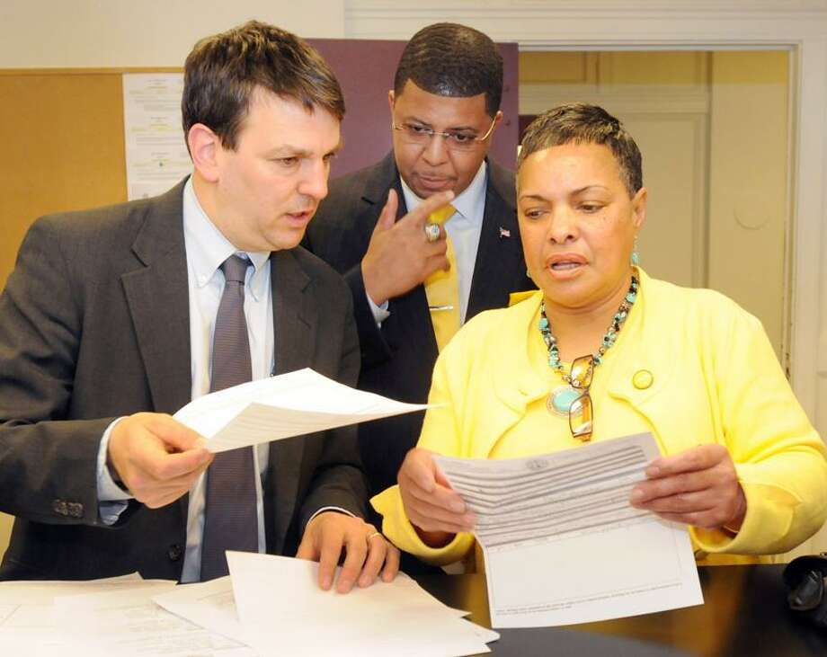 Ken Krayeske of the Democracy Fund, left, New Haven Democratic Mayoral candidate Kermit Carolina, center and New Haven Deputy City Clerk Sally Brown as Carolina files his papers to run for mayor Tuesday, April 30, 2013 at the New Haven Hall of Records.  Photo by Peter Hvizdak / New Haven Register Photo: New Haven Register / ©Peter Hvizdak /  New Haven Register