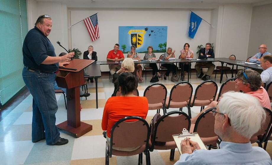 "Woodbridge-- Greg Laugeni speaks during a public hearing before the vote for the bonding referendum for the artificial turf field at Amity High. He is an Amity High alumni from the class of '82.  Photo-Peter Casolino/Register <a href=""mailto:pcasolino@newhavenregister.com"">pcasolino@newhavenregister.com</a>"