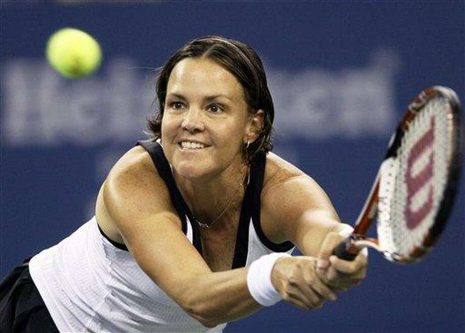 "FILE - In this Aug. 27, 2008 file photo, Lindsay Davenport makes a return against Alisa Kleybanova at the U.S. Open tennis tournament in New York. Chris Evert and Lindsay Davenport are taking a swing at acting as guest stars on ""CSI.""  (AP Photo/Elise Amendola, File) Photo: AP / AP"