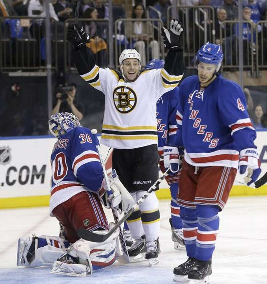 Boston Bruins' Gregory Campbell, center, reacts along with New York Rangers goalie Henrik Lundqvist, left, and Michael Del Zotto to a goal by Boston Bruins' Johnny Boychuk during the third period in Game 3 of the Eastern Conference semifinals in the NHL hockey Stanley Cup playoffs in New York Tuesday, May 21, 2013, in New York. The Bruins won 2-1 and lead the best-of-seven games series 3-0. (AP Photo/Seth Wenig) Photo: AP / AP