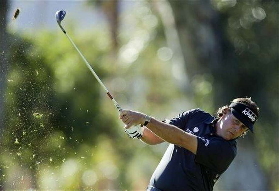 Phil Mickelson hits from a fairway on the fifth hole during the first round of the Humana Challenge golf tournament at the La Quinta Country Club in La Quinta, Calif., Thursday, Jan. 17, 2013. (AP Photo/Chris Carlson) Photo: AP / AP