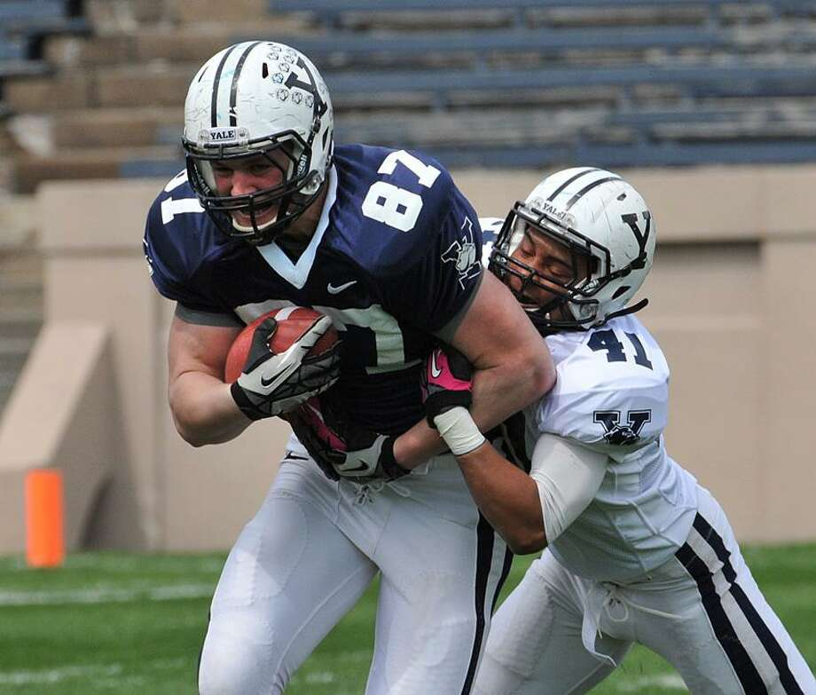 "New Haven-- Yale TE Michael Leunen drives for extra yards as Roger Kilgore III defends during the annual spring football scrimmage .Photo-Peter Casolino/Register <a href=""mailto:pcasolino@newhavenregister.com"">pcasolino@newhavenregister.com</a>"
