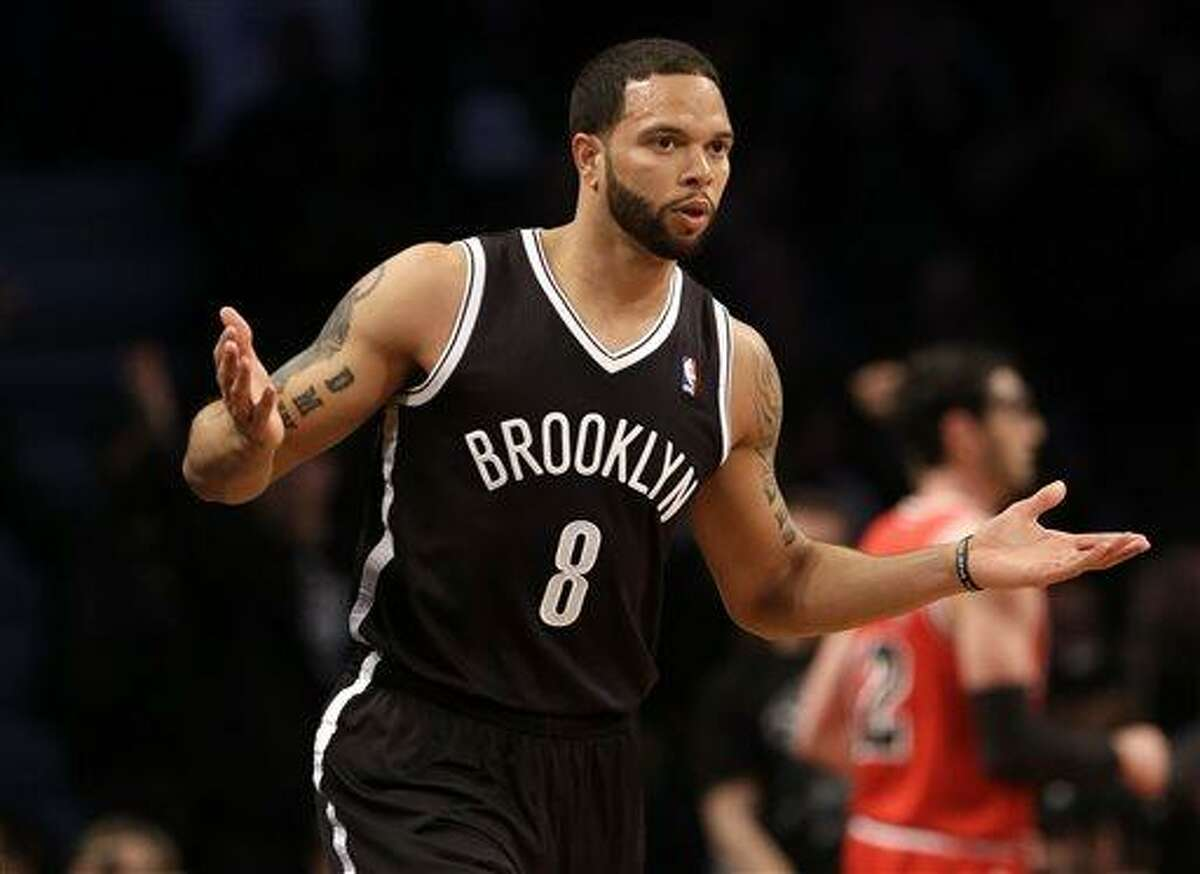 Brooklyn Nets' Deron Williams reacts after scoring against the Chicago Bulls during the first quarter of Game 1 of a first-round series of the NBA basketball playoffs, Saturday, April 20, 2013, in New York. (AP Photo/Seth Wenig)