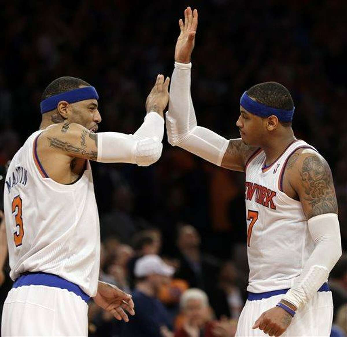 New York Knicks forward Kenyon Martin, left, and teammate Carmelo Anthony celebrate after the Knicks went ahead in the fourth quarter of Game 1 of the NBA basketball playoffs in New York, Saturday, April 20, 2013. (AP Photo/Kathy Willens)in New York, Saturday, April 20, 2013. The Knicks defeated Celtics 85-78. (AP Photo/Kathy Willens)