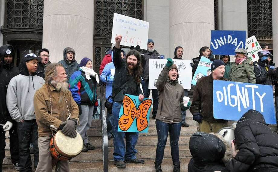 New Haven-- Immigrants' rights activists protest in front of the Federal Courthouse in New Haven. Activists groups across the country have declared MLK day and Obama's inauguration to be a National Day of Action for Comprehensive Immigration Reform. Photo-Peter Casolino 1/21/13