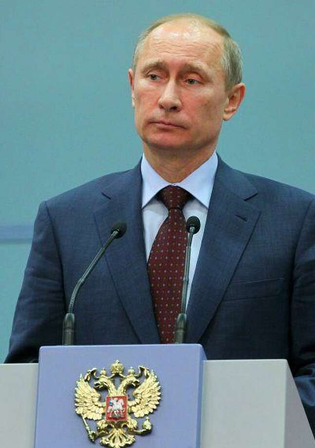 Russian President Vladimir Putin at a news conference in the Black Sea resort of Sochi, Russia on Friday. Photo: ASSOCIATED PRESS / AP2013