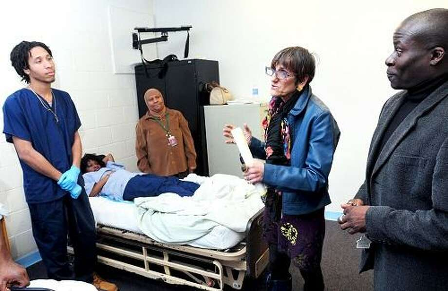 Congresswoman Rosa DeLauro (center right) tours a CNA skills class at the New Haven Job Corps Center on 3/22/2013.  Left to right are Tyler Boyd of West Haven, Tyetta Henderson of New Haven, their instructor R.N. Bahiyah Muhammad, DeLauro and Kevin Green, Career Technical Training Manager.Photo by Arnold Gold/New Haven Register   AG0489B