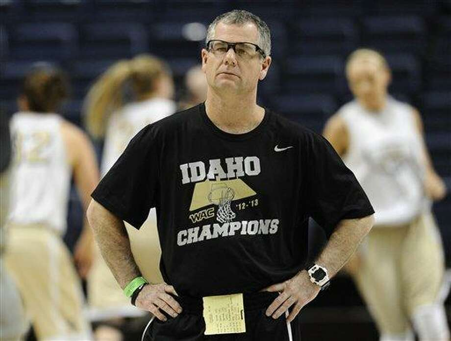 Idaho head coach Jon Newlee watches his team practice for a first-round game in the women's NCAA college basketball tournament in Storrs, Conn., Friday, March 22, 2013. Idaho will play Connecticut on Saturday. (AP Photo/Jessica Hill) Photo: AP / FR125654 AP