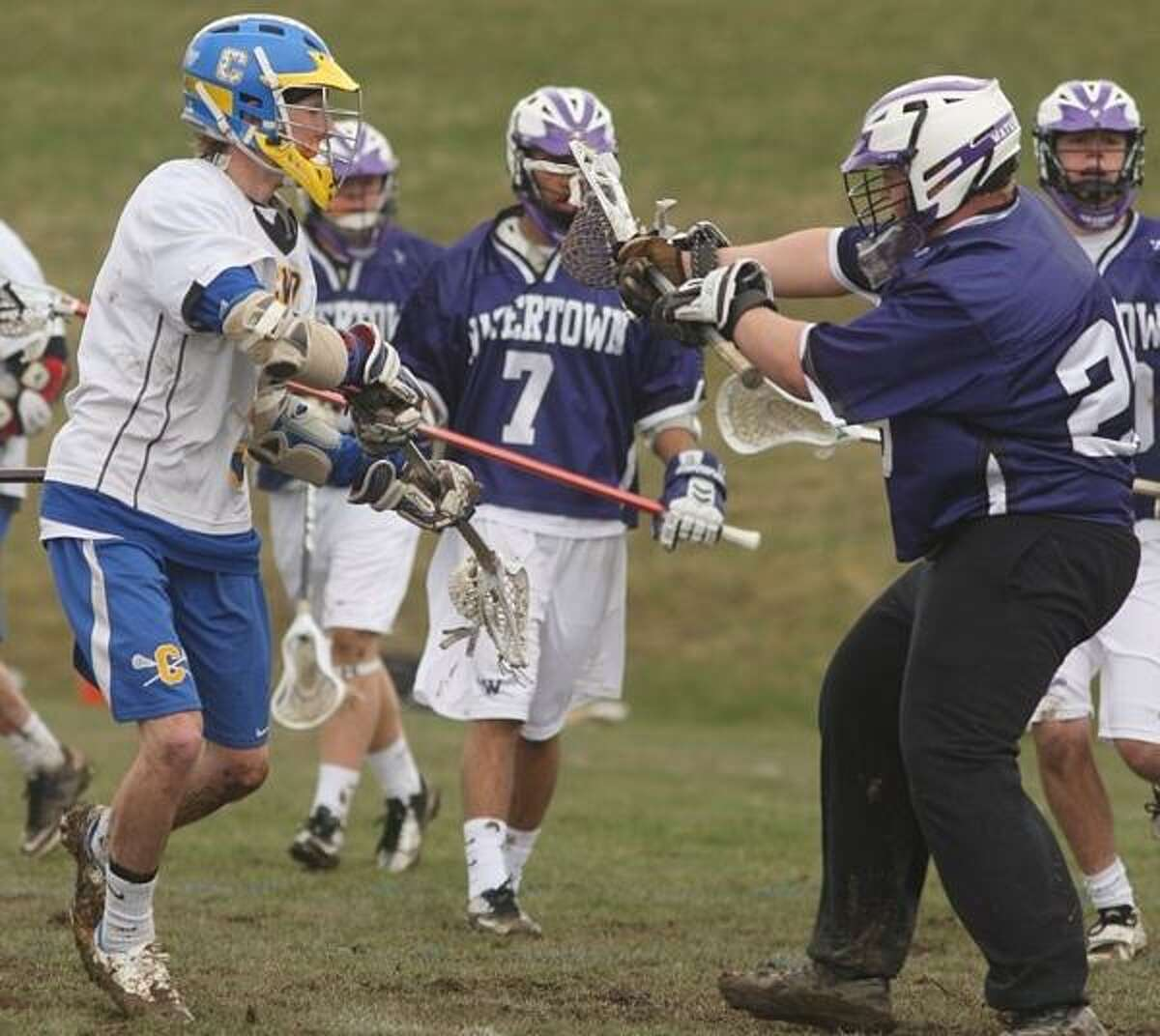 PHOTO BY JOHN HAEGER @ ONEIDAPHOTO ON TWITTER/ONEIDA DAILY DISPATCH Cazenovia's Conor Race (5) puts a shot past Watertown goalie Mike Gleason (26) to score the Lakers' 12th goal of the first half of their game on Saturday, April 20, 2013 in Cazenovia.