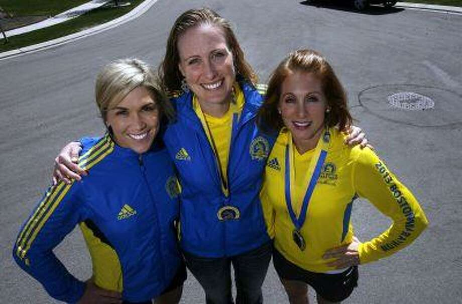 Chelsea Larson, left, Rachel Moody, and Belinda Osborne, right, all ran in the Boston Marathon, and are planning to run in Saturday's Salt Lake City Marathon just five days after the bombings that rocked the finish line in Boston. They posed for a photo Thursday, April 17, 2013 in Draper, Utah. Photo: Scott Sommerdorf / The Salt Lake Tribune