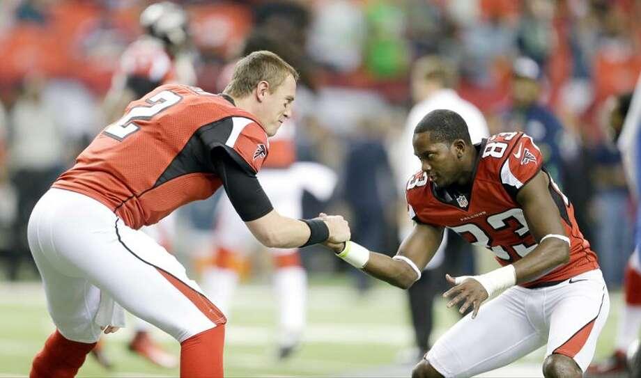 Atlanta Falcons' Matt Ryan (2) and Dunta Robinson (23). (AP Photo/David Goldman) Photo: AP / AP2013
