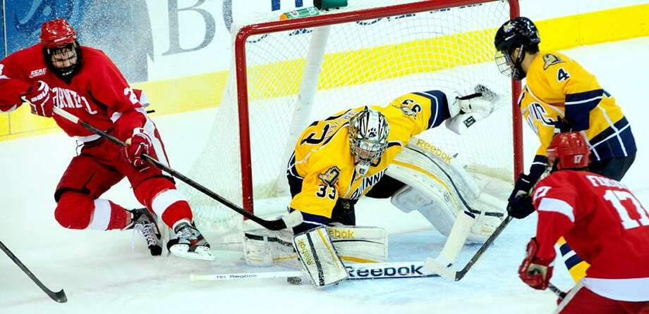 Goalie Eric Hartzell guards the Quinnipiac net. Photo by Arnold Gold/New Haven Register   AG0488A