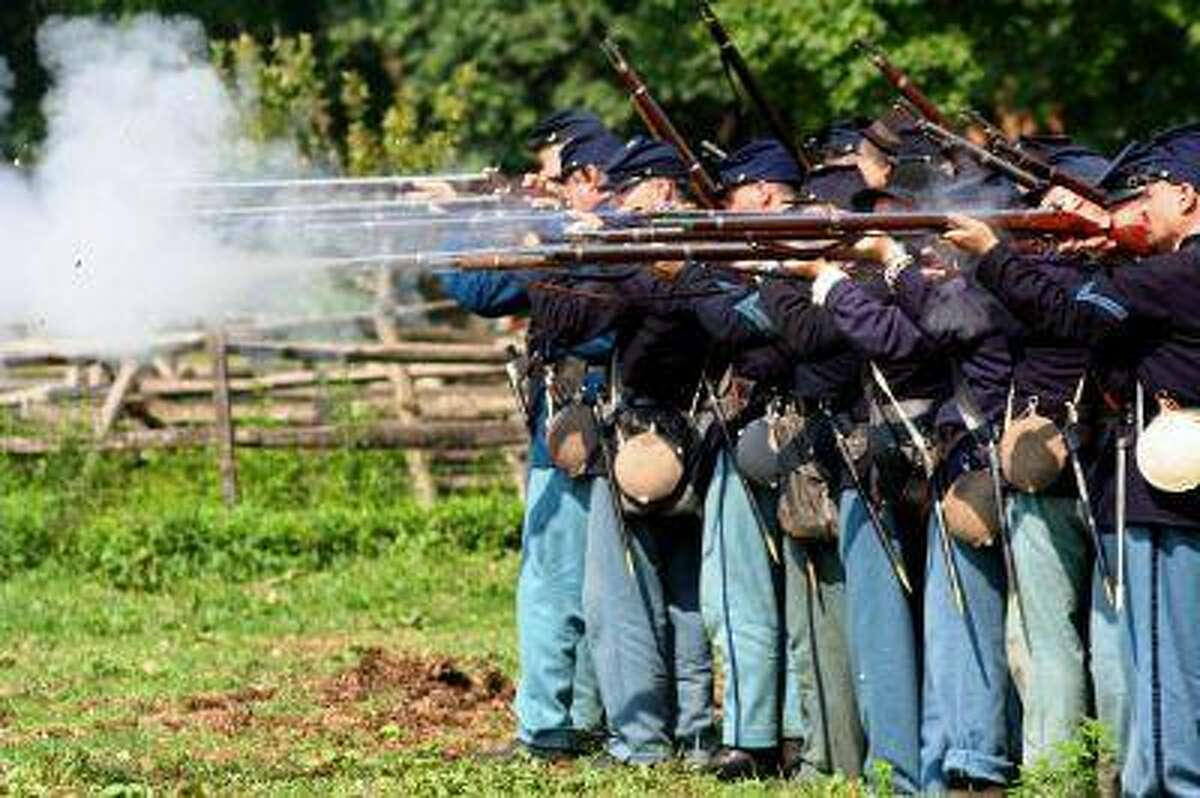 Union Army re-enactors like these will be out in force for re-enactments at Gettysburg this summer. The fact that actual firearms are used during the re-enactments are is cause for lengthy safety guidelines. (Lebanon Daily News -- File)