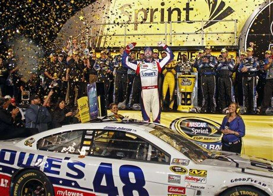 Jimmie Johnson celebrates in victory lane after winning the NASCAR All-Star auto race at Charlotte Motor Speedway in Concord, N.C., Saturday, May 18, 2013. (AP Photo/Nell Redmond) Photo: AP / FR25171 AP