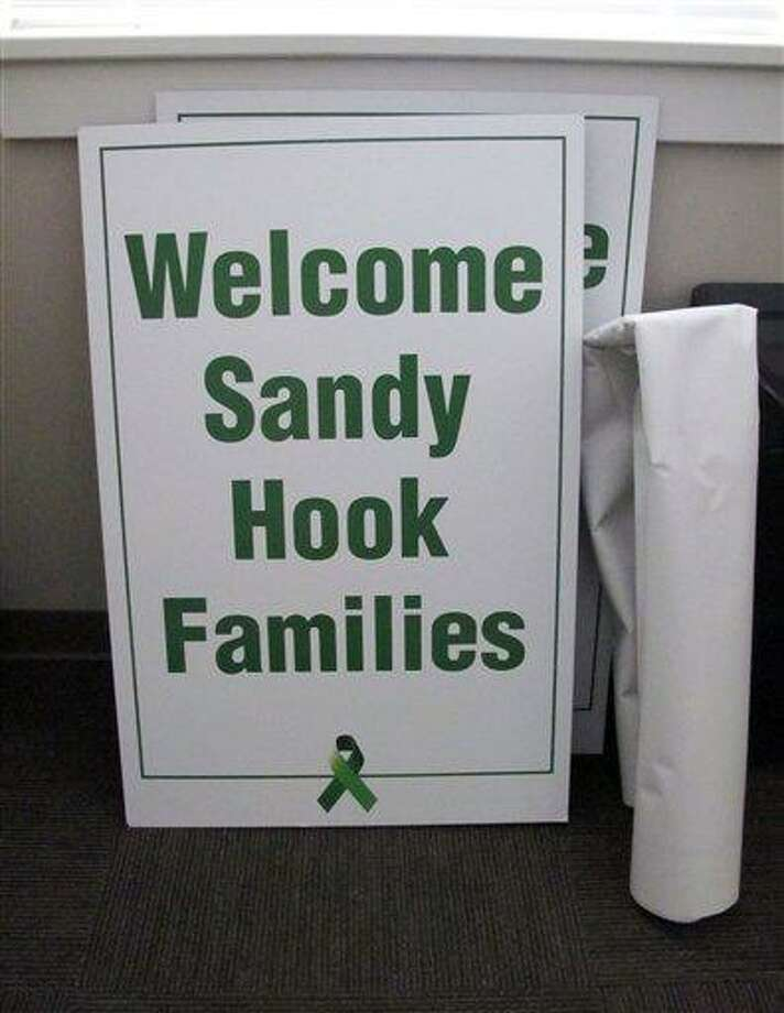Donated signs and banners await transport from the Newtown Youth Academy to the Chalk Hill School in Monroe, Conn., Monday, Dec. 31, 2012. Parents are bracing to send their children back to school, nearly three weeks after the shooting rampage at Sandy Hook Elementary School in Newtown. The school is set to open Thursday, Jan. 3, 2013 for students from the Sandy Hook Elementary School, where a gunman killed 26 people on Dec. 14. (AP Photo/Pat Eaton-Robb) Photo: ASSOCIATED PRESS / AP2012