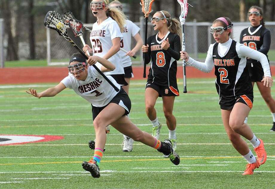 """Cheshire-- Cheshire's Kathleen Kalbian gets tripped up by Shelton's Carey Shomsky during the first half. Photo-Peter Casolino/Register <a href=""""mailto:pcasolino@newhavenregister.com"""">pcasolino@newhavenregister.com</a>"""