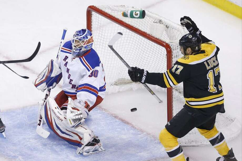 May 19, 2013; Boston, MA, USA; Boston Bruins left wing Milan Lucic (17) celebrates a goal by defenseman Torey Krug (not pictured) on New York Rangers goalie Henrik Lundqvist (30) during first period in game two of the second round of the 2013 Stanley Cup Playoffs at TD Garden.  (Greg M. Cooper-USA TODAY Sports) Photo: USA TODAY Sports / Greg M. Cooper