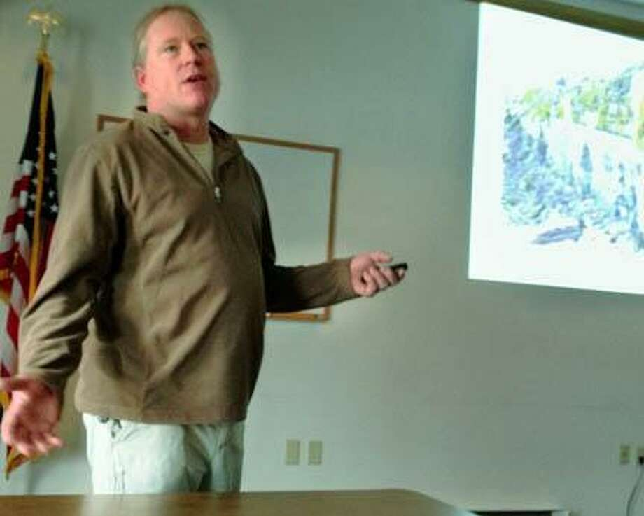 "Dispatch Staff Photo by JOHN HAEGER <a href=""http://twitter.com/oneidaphoto"">twitter.com/oneidaphoto</a> Dr. Adam Schoonmaker talks about the geology of the area during the  Citizens for Safe Energy Natural Gas Development meeting entitled ""The Basics for Madison County""  on Saturday, Jan. 19, 2013 at The Hamilton Public Library."