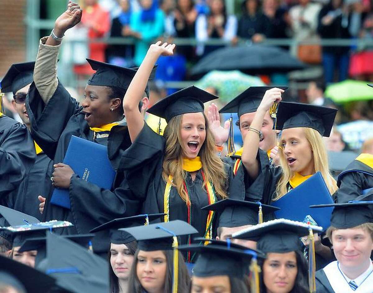 Students celebrate Quinnipiac University, college of Arts and Sciences, and School of Business commencement, including Alexandra Bachyrycz of Oxford, center. Mara Lavitt/New Haven Register mlavitt@newhavenregister.com5/19/13