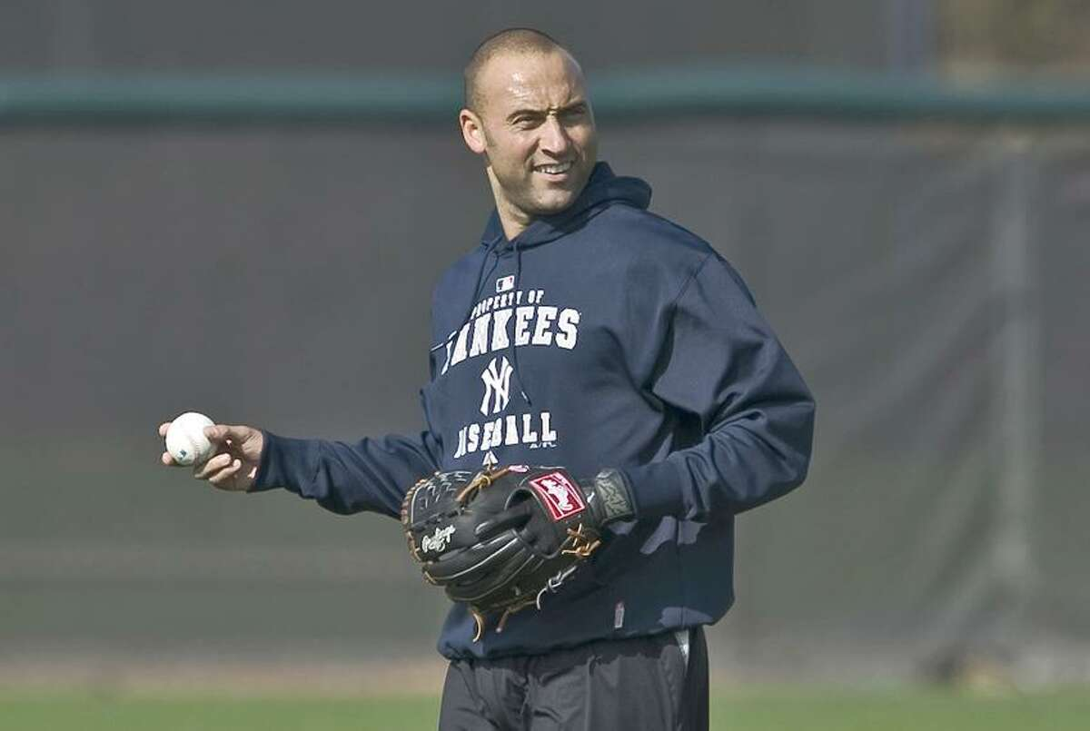 New York Yankees shortstop Derek Jeter loosens up during an informal workout at the team's minor league training complex in Tampa, Florida, February 11, 2013. Pitchers and catchers report for the first day of spring training on Tuesday. REUTERS/Steve Nesius